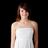 Teen girl. In white dress, isolated on black background stock photos