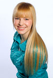 Teen girl. With blond hair in blue jacket Stock Image