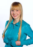 Teen girl. With blond hair in blue jacket Royalty Free Stock Photo