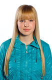 Teen girl. With blond hair in blue jacket Royalty Free Stock Photos