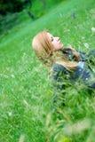 Teen girl. Beautiful teen blond girl staying in the meadow Stock Image