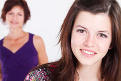 Teen girl. Portrait in studio, background is her middle aged mother Royalty Free Stock Photography