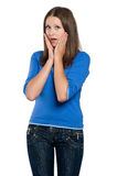 Teen girl. Portrait of a shocked teen girl against isolated white background Stock Image