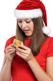 Teen girl. Beautiful teen girl in Santa hat with gift box posing on white background Stock Photo