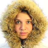 Teen girl. Attractive girl on white background in parka stock photo