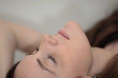 Teen girl. Attractive girl reclining head back royalty free stock photos