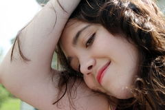 Teen girl. Leaning head down beauty Royalty Free Stock Photography