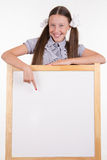Teen girl advertises inscription on the stand Royalty Free Stock Photo