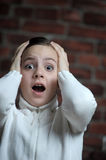 Teen girl afraid. Teen girl with a frightened look on his face royalty free stock photo