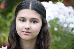Teen girl against white phlox. A teen girl against a white phlox Royalty Free Stock Photography