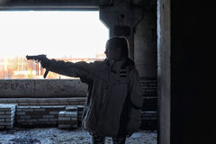 Teen girl aiming. A gun Royalty Free Stock Photography