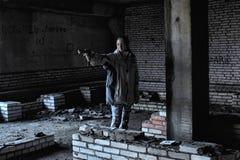Teen girl aiming. A gun Royalty Free Stock Photos
