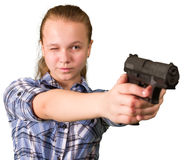Teen girl aiming from the gun Royalty Free Stock Images