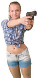 Teen girl aiming from the gun Stock Photo