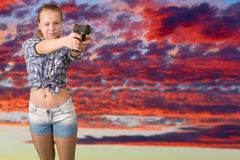 Teen girl aiming from the gun Royalty Free Stock Image