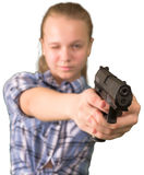 Teen girl aiming from the gun  on white Royalty Free Stock Images