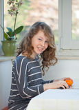 Teen girl with apple Stock Photo