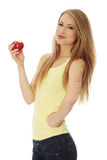 Teen girl and apple Stock Images
