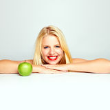 Teen girl with an apple Stock Images
