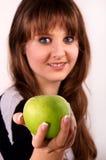 Teen girl and an apple. Stock Image