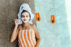 Teen Girl Applying Organic Fruit Facial Mask Royalty Free Stock Image