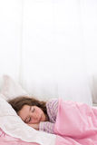 Teen girl Asleep shuching her thumb Stock Photos