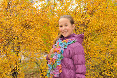 Teen girl in autumn city garden Royalty Free Stock Image