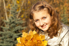 Teen girl in autumn park Royalty Free Stock Photos