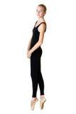 Teen girl ballerina dancer in black tricot. Over white background Stock Image