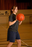 Teen Girl with Basketball. Pretty Teen Girl with Basketball in Gym Stock Images