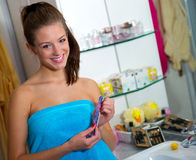 Teen girl in bathroom Royalty Free Stock Image