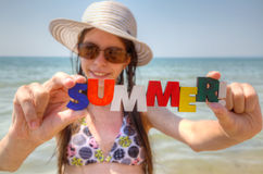 Teen girl at a beach. With word 'Summer Royalty Free Stock Photography