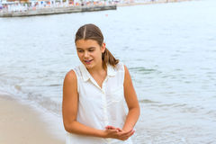 Teen girl on the beach. Against the sea Stock Photos