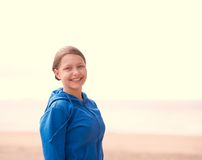 Teen girl on a beach. Cute happy teen girl staying on a beach and smiling Stock Photo