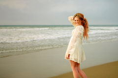 Teen girl at the beach smiling. Sexy teen girl in white lace dress Stock Photo