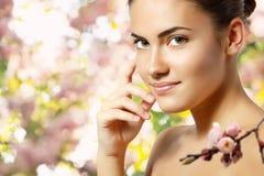 Teen girl beautiful cheerful enjoying over spring Japanese cherr. Y tree background Royalty Free Stock Image