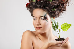 Teen girl beautiful ecology with green tree shoot Stock Photos