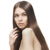 Young beautiful woman with long glossy hair. Teen girl beauty portrait with beautiful bright brown long hair isolated on white background Royalty Free Stock Photos