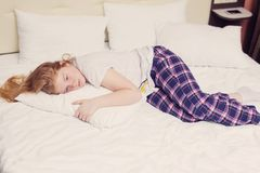 The teen girl on bed. The teen girl on the bed royalty free stock image