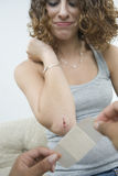 Teen girl being bandaged. Stock Photos
