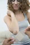 Teen girl being bandaged. Stock Photos
