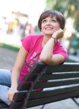 Teen girl on the bench Stock Photos