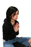 Teen girl with Bible Praying on Isolated Background Stock Photo