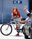 Teen girl on bicycle argue with man in car Stock Photography