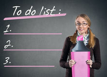 Teen girl with big marker  and to do list Royalty Free Stock Photo