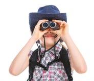 Teen girl with binocular Stock Images