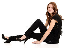 Teen girl in black sitting Royalty Free Stock Photos