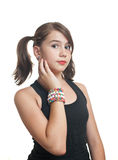 Teen girl in black top with pigtails smiling Stock Images