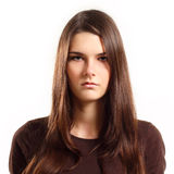 Teen girl with blank facial expression. Isolated on white background Royalty Free Stock Photos