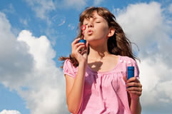 Teen girl blow bubbles Royalty Free Stock Photo